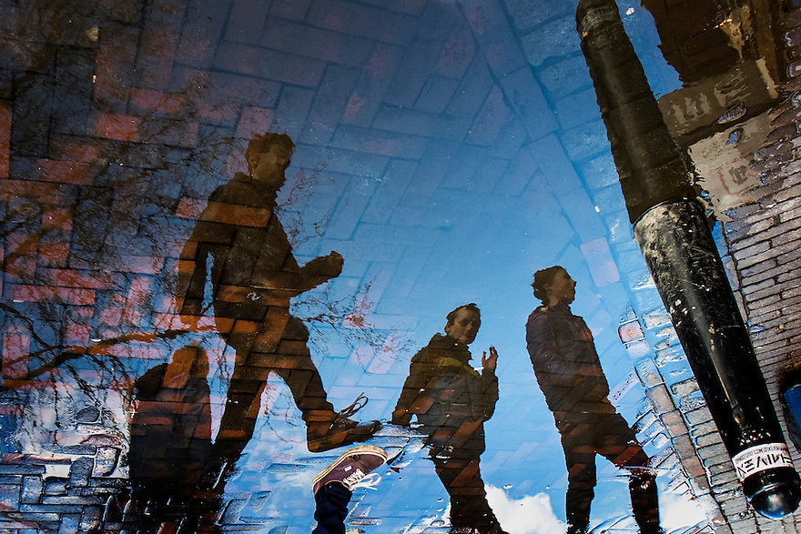 Nederland, Utrecht, 21 feb 2014<br /> Reflectie van groepje jongens in een plas water. Foto staat op z'n kop.  <br /> <br /> Foto(c): Michiel Wijnbergh
