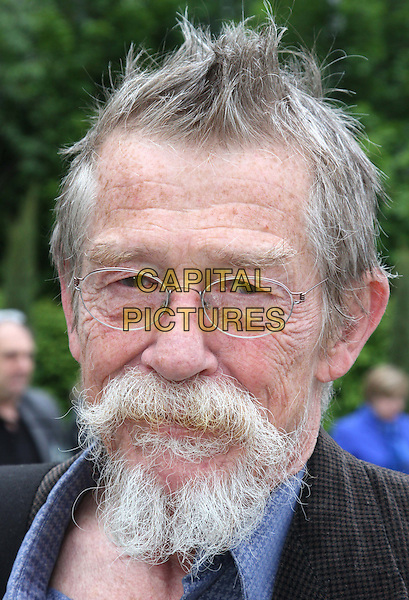 John Hurt<br /> RHS Chelsea Flower Show Press and VIP Day at Royal Hospital Chelsea, London, England.<br /> May 21st 2012<br /> headshot portrait black blue shirt goatee facial hair glasses <br /> CAP/ROS<br /> &copy;Steve Ross/Capital Pictures