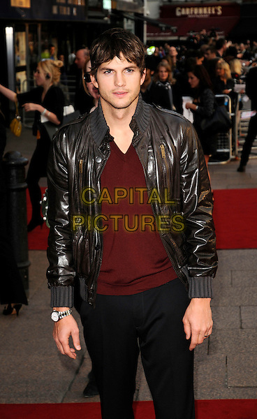 "ASHTON KUTCHER.World premiere of ""What Happens In Vegas"" held at the Odeon Leicester Square, London, England. .April 22nd 2008.half length black brown leather jacket stubble facial hair red v-neck top .CAP/CAN.©Can Nguyen/Capital Pictures."