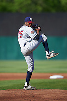 Mahoning Valley Scrappers starting pitcher Juan Hillman (25) delivers a warmup pitch during a game against the Auburn Doubledays on June 19, 2016 at Falcon Park in Auburn, New York.  Mahoning Valley defeated Auburn .  (Mike Janes/Four Seam Images)