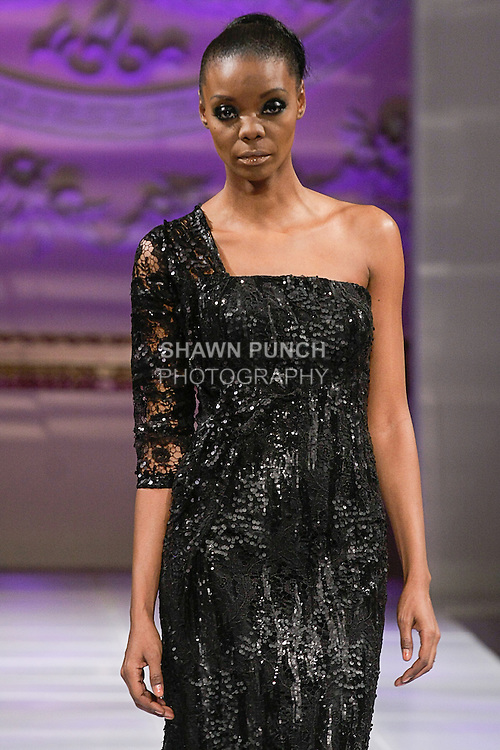 Model walks runway in an outfit from the Laila Wazna collection, by Saudi Arabian designer Laila Wazna, during Couture Fashion Week Fall 2013 in New York, February 16, 2013.