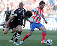 Atletico de Madrid's Adrian Lopez (r) and Granada's Diego Mainz (l) and Filipe Luis (c) during La Liga match.April 14,2013. (ALTERPHOTOS/Acero)