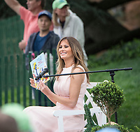 Washington DC, April 17, 2017, USA:First Lady Melania Trump reads to visitors to the South Lawn of the White House for the 139th Annual Easter Egg roll and event in Washington DC. <br /> CAP/MPI/LYN<br /> &copy;LYN/MPI/Capital Pictures