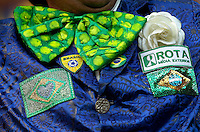 Detailed shot of a Brazilian fans badges and large bow tie
