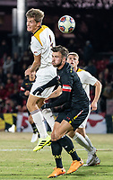 COLLEGE PARK, MD - NOVEMBER 21: Ignacio Antequera-Sanchez #4 of Iona heads over Johannes Bergman #5 of Maryland during a game between Iona College and University of Maryland at Ludwig Field on November 21, 2019 in College Park, Maryland.