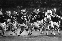 Oakland Raiders vs. Baltimore Colts: Raiders Art Thoms, Joe Carrol, Harold Rice, Duane Benson, and Al Dotson chasing Colt quarterback. (1971 pre-season?<br />