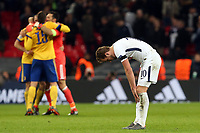 As Juventus players celebrate the victory a despondent  Harry Kane of Tottenham Hotspur after Tottenham Hotspur vs Juventus, UEFA Champions League Football at Wembley Stadium on 7th March 2018