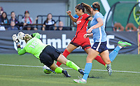 Portland, Oregon - Saturday July 2, 2016: Sky Blue FC goalkeeper Caroline Stanley (18) makes a save in front of Portland Thorns FC forward Nadia Nadim (9) during a regular season National Women's Soccer League (NWSL) match at Providence Park.