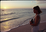 Woman watching sunset on Sanibel Island