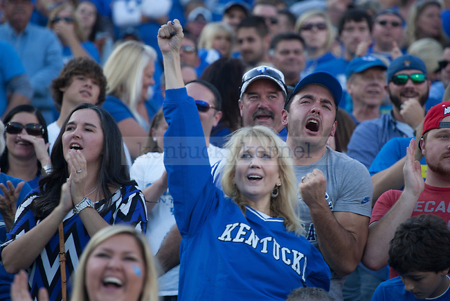 UK fans cheer during the first half of the Kentucky Wildcats game against the Mississippi State Bulldogs at Commonwealth Stadium on Saturday, October 25, 2014 in Lexington, Ky. Mississippi leads Kentucky 17-10. Photo by Adam Pennavaria | Staff