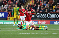 André Green of Charlton Athletic tackled by Romaine Sawyers of West Bromwich Albion during Charlton Athletic vs West Bromwich Albion, Sky Bet EFL Championship Football at The Valley on 11th January 2020