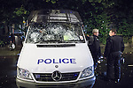 © Joel Goodman - 07973 332324 . 08/08/2011 . London , UK . A police van with smashed windscreen in Brixton during a 2nd night of rioting and looting in London , which followed a protest against the police shooting of Mark Duggan in Tottenham . Photo credit : Joel Goodman