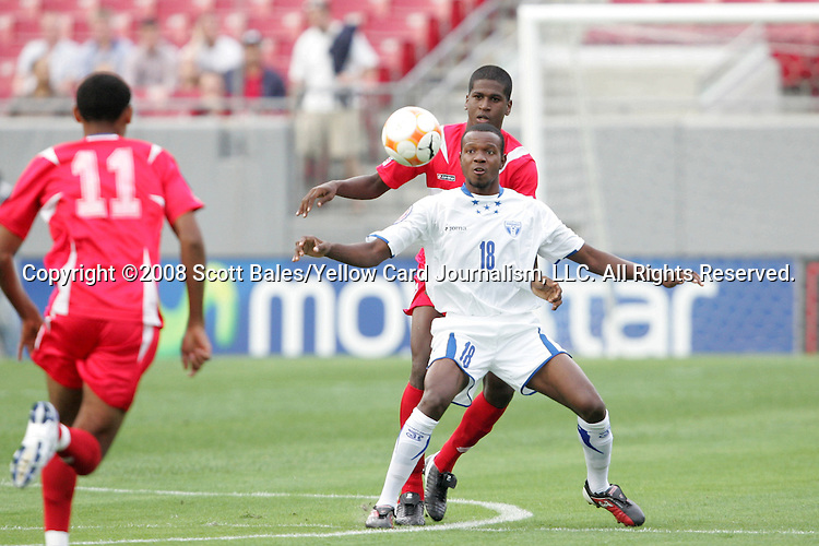 11 March 2008: Jose Cesar Guity (HON) (18) shields a Panama player off the ball. The Honduras U-23 Men's National Team defeated the Panama U-23 Men's National Team 1-0 at Raymond James Stadium in Tampa, FL in a Group A game during the 2008 CONCACAF's Men's Olympic Qualifying Tournament.