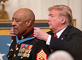United States President Donald J. Trump awards the Medal of Honor to Sergeant Major John L. Canley, United States Marine Corps (Retired), for conspicuous gallantry during the Vietnam War in a ceremony in the East Room of the the White House in Washington, DC on Wednesday, October 17, 2018.<br /> Credit: Ron Sachs / CNP