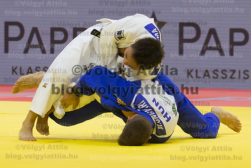 Miklos Ungvari (bottom) of Hungary and Masashi Ebinuma (top) of Japan fight during the Men -73 kg category at the Judo Grand Prix Budapest 2018 international judo tournament held in Budapest, Hungary on Aug. 11, 2018. ATTILA VOLGYI