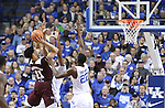 Forward Alex Poythress and Forward Marcus Lee of the Kentucky Wildcats attempt to block Quinndary Weatherspoon's shot during the game against the Mississippi State Bulldogs at Rupp Arena on January 20, 2015 in Lexington, Kentucky. Photo by Taylor Pence