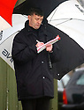 1/2/04          Copyright Pic : James Stewart.File Name : jspa15_spartans.LIVINGSTON'S PAUL HEGGARTY BRAVES THE RAIN AS HE WATCHES NEXT WEEK'S CUP OPPOSITION DURING THE SECOND HALF......James Stewart Photo Agency 19 Carronlea Drive, Falkirk. FK2 8DN      Vat Reg No. 607 6932 25.Office     : +44 (0)1324 570906     .Mobile  : +44 (0)7721 416997.Fax         :  +44 (0)1324 570906.E-mail  :  jim@jspa.co.uk.If you require further information then contact Jim Stewart on any of the numbers above.........