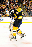 Boston Bruins left wing Milan Lucic #17 charges Buffalo Sabres goalie Ryan Miller #30 separating him from his mask. Boston Bruins left wing Milan Lucic #17 charge earned him a penalty for his efforts.