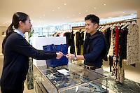HONG KONG - MAY 04: Jonathan Lui buys in a fashion store in Landmark shopping mall in Central business district, on May 4, in Hong Kong. (Photo by Lucas Schifres/Pictobank)