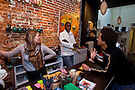BRUSSELS - BELGIUM - 07 JANUARY 2012 -- Marolles the bohemian city part of Brussels. -- Cafe Aksum (Rue Haute 140), Ethiopian cafe specialized in Ethiopian coffee. Cafe personal My (Fin.), Pape (Senegal) and Dawid (ri) (Eritrea) -- PHOTO: Juha ROININEN /  EUP-IMAGES