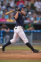 Asheville Tourists center fielder David Dahl #21 swings at a pitch during a game against the Savannah Sand Gnats at McCormick Field July 17, 2014 in Asheville, North Carolina. The Tourists defeated the Sand Gnats 8-7. (Tony Farlow/Four Seam Images)
