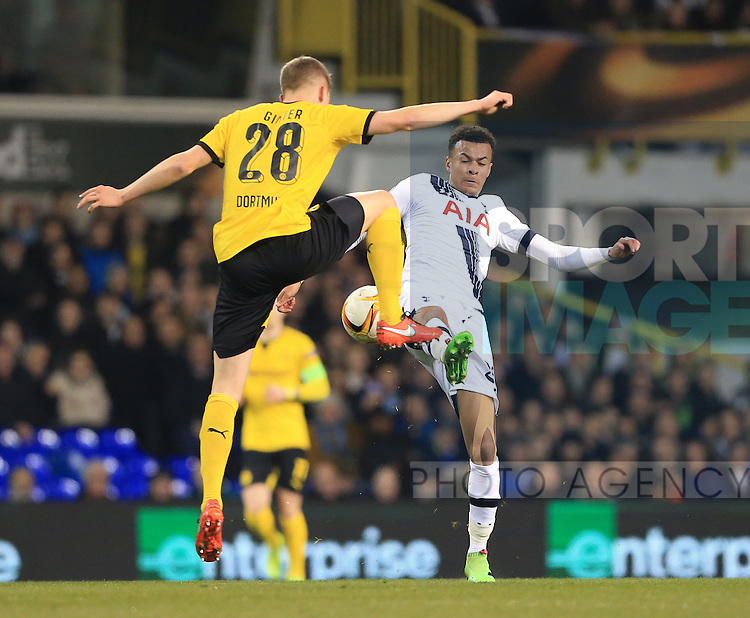 Tottenham's Dele Alli tussles with Dortmund's Matthias Ginter during the Europa League match at White Hart Lane Stadium.  Photo credit should read: David Klein/Sportimage