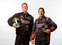 Feb 6, 2019; Pomona, CA, USA; NHRA pro stock drivers Jason Line (left) and teammate Greg Anderson pose for a portrait during NHRA Media Day at the NHRA Museum. Mandatory Credit: Mark J. Rebilas-USA TODAY Sports