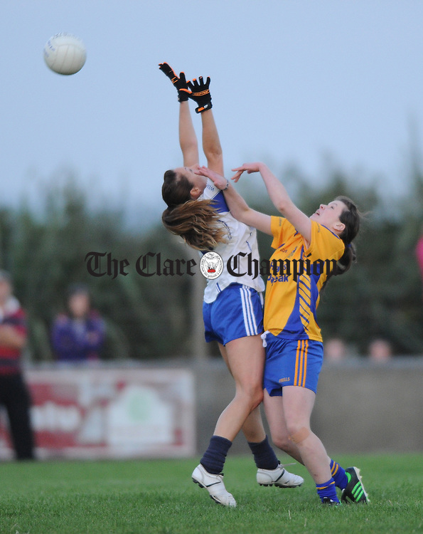 Fiona Troy of West Clare Gaels in action against Aoife Keane of Banner Ladies during their senior Football county final at Doonbeg. Photograph by John Kelly.