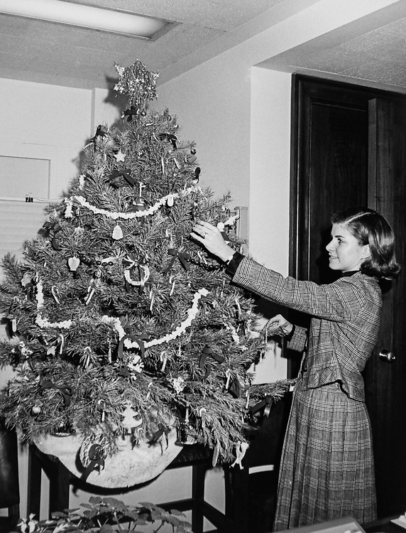 Office staff member decorating Christmas tree. (Photo by Dev O'Neill/CQ Roll Call via Getty Images)