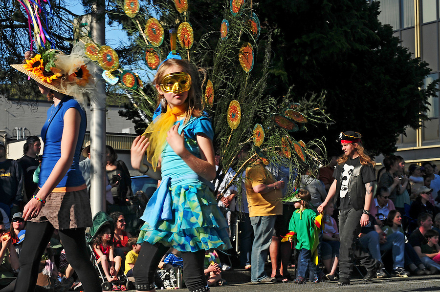A Procession of the Species participant in a peacock costume entertains the crowd in Olympia, Washington.