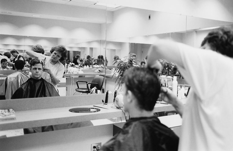 Dan Blankenburg, Legislative Assistant to Rep. Thomas W. Ewing, R-Ill., receives a haircut from Edie Romonoski at Capital Styles Salon on Oct. 5, 1995. (Photo by Laura Patterson/CQ Roll Call via Getty Images)
