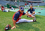 12 July 2008: Washington Nationals' catcher Jesus Flores (foreground) stretches out as relief pitcher Luis Ayala (legs crossed) looks on, prior to batting practice and a game against the Houston Astros at Nationals Park in Washington, DC. The Astros defeated the Nationals 6-4 in the second game of their 3-game series...Mandatory Photo Credit: Ed Wolfstein Photo