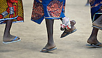 Women--including one with ankle rattles--dance during a conference on peacebuilding in Abyei, a contested region along the border between Sudan and South Sudan. Under a 2005 peace agreement, the region was supposed to have a referendum to decide which country it would join, but the two countries have yet to agree on who can vote. In 2011, militias aligned with Khartoum drove out most of the Dinka Ngok residents, pushing them across a river into the town of Agok. Yet more than 40,000 Dinka Ngok have since returned with support from Caritas South Sudan, which has drilled wells, built houses, opened clinics and provided seeds and tools for the returnees. Peace remains elusive, however, and Caritas is supporting a series of conferences between all the stakeholders in the area.