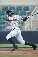 Johan Cruz (5) of the Kannapolis Intimidators follows through on his swing against the West Virginia Power at Kannapolis Intimidators Stadium on July 25, 2018 in Kannapolis, North Carolina. The Intimidators defeated the Power 6-2 in 8 innings in game one of a double-header. (Brian Westerholt/Four Seam Images)