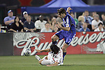 23 April 2009:  Alfredo Pacheco (on ground) of the Red Bulls slide tackles the ball away from Claudio Lopez (7) of the Wizards.  The MLS Kansas City Wizards defeated the visiting New York Red Bulls 1-0 at Community America Ballpark in Kansas City, Kansas.