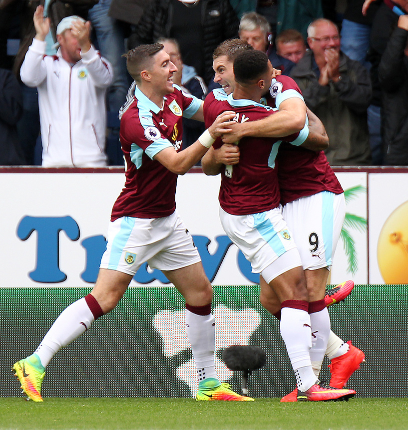 Burnley's Sam Vokes (no.9) celebrates with team mates after scoring the opening goal  <br /> <br /> Photographer Rich Linley/CameraSport<br /> <br /> Football - The Premier League - Burnley v Liverpool - Saturday 20 August 2016 - Turf Moor - Burnley<br /> <br /> World Copyright &copy; 2016 CameraSport. All rights reserved. 43 Linden Ave. Countesthorpe. Leicester. England. LE8 5PG - Tel: +44 (0) 116 277 4147 - admin@camerasport.com - www.camerasport.com