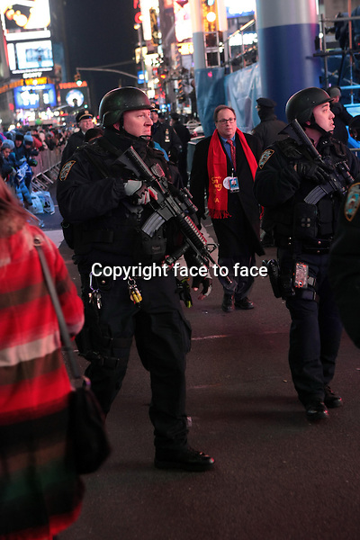 New York, NY-December 31: NYPD Officer at the 2014 New Years Eve Celebration held in Times Square on December 31, 2013 in New York City.<br /> Credit: MediaPunch/face to face<br /> - Germany, Austria, Switzerland, Eastern Europe, Australia, UK, USA, Taiwan, Singapore, China, Malaysia, Thailand, Sweden, Estonia, Latvia and Lithuania rights only -