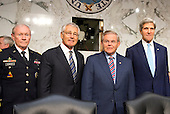 """From left to right: Chairman of the Joint Chiefs of Staff General Martin E. Dempsey, United States Army; U.S. Secretary of Defense Chuck Hagel; U.S. Senator Robert Menendez (Democrat of New Jersey), Chairman of the U.S. Senate Foreign Relations Committee; and U.S. Secretary of State John Kerry pose for a group photo prior to the U.S. Senate Foreign Relations Committee hearing on """"Authorization of Use of Force in Syria""""  on Capitol Hill in Washington, D.C. on Tuesday, September 3, 2013.<br /> Credit: Ron Sachs / CNP"""