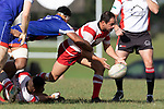 Savelio Ropati fails to stop Andrew West from clearing the ball from a ruck. Counties Manukau Premier Club Rugby game between Karaka and Ardmore Marist, played at the Karaka Sports Park on Saturday April 21st 2008. Ardmore Marist won the game 29 - 7 after being 7 all at halftime.<br /> Karaka 7 -Kalione Hala try, Juan Benadie conversion.<br /> Ardmore Marist South Auckland Motors (Counties Power Cup Holders) 29 - Sione Tuipulotu, Bryan Mulitalo, Damon Leasuasu, Joseph Ikenasio tries, Latiume Fosita 3 conversions, Latiume Fosita penalties.<br /> Photo by Richard Spranger
