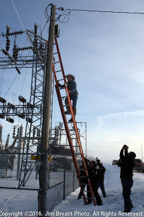 Activists LaVoy Finicum at a power station near the Malheur National Wildlife Reserve on January 15, 2016 in Burns, Oregon.  Ammon Bundy and about 20 other protesters took over the refuge on Jan. 2 after a rally to support the imprisoned local ranchers Dwight Hammond Jr., and his son, Steven Hammond. Another surveillance camera was found near the reserve. ©2016. Jim Bryant Photo. All Rights Reserved.