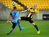 Sydney's Michael Zullo clears under pressure from Wellington's Adam Parkhouse during the A-League football match between Wellington Phoenix and Sydney FC at Westpac Stadium in Wellington, New Zealand on Saturday, 23 December 2017. Photo: Dave Lintott / lintottphoto.co.nz
