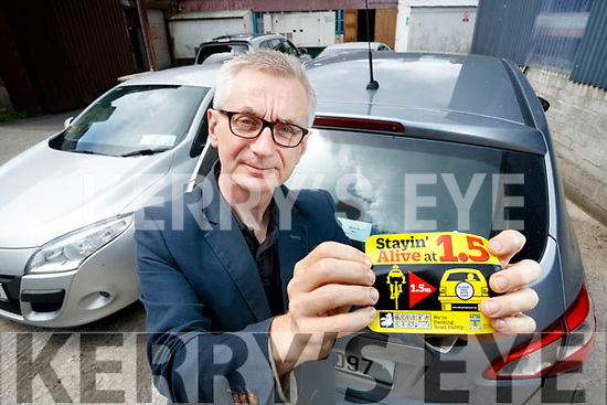"Colin Lacey, Editor of Kerry's Eye with the ""Stayin Alive at 1.5"" Car Sticker which is free in this week's Kerry's Eye."