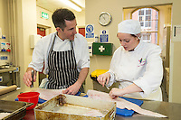 Mark Anderson of the Ruddington Arms bones cod with Claire Chocholko