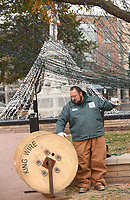 NWA Democrat-Gazette/FLIP PUTTHOFF<br />DOWN COME THE LIGHTS<br />Chris Kester with Bentonville Parks and Rereation takes down Christmas lights Tuesday Jan. 2 2017 on the Bentonville square. It takes a crew about two weeks to take down and pack away the miles of city Christmas lights, Kester said.
