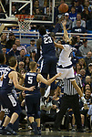 Nevada forward Caleb Martin's shot is blocked by Utah State forward Neemias Queta (23) in the second half of an NCAA college basketball game in Reno, Nev., Wednesday, Jan. 2, 2019. (AP Photo/Tom R. Smedes)