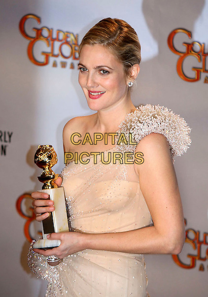 DREW BARRYMORE .Press Room at the 67th Golden Globe Awards, he Beverly Hilton Hotel, Beverly Hills, California, USA, .January 17th, 2010.globes pressroom half length beige silver one shoulder dress hair up trophy award winner beaded.CAP/AW/MAZ .©Maz/Weber/Capital Pictures