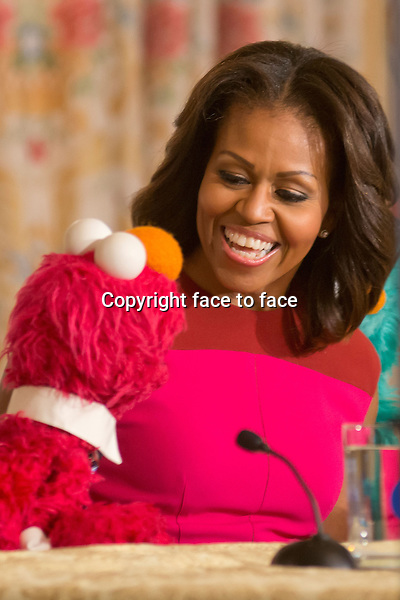 Washington, DC, October 30,2013--First Lady Michelle Obama holds a press conference to announce a new partnership with Seasame Street and the White House to promote heathy eating.She chats with Elmo, one the Sesame Street characters. <br />