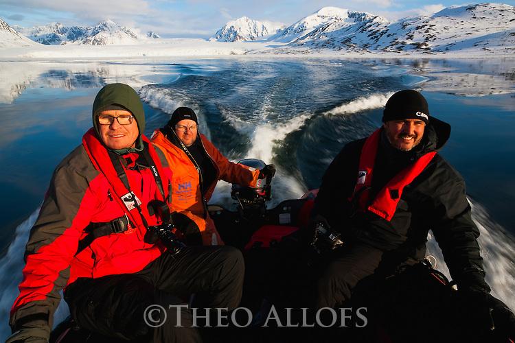 Norway, Svalbard, Zodiak cruise in fjord at midnight