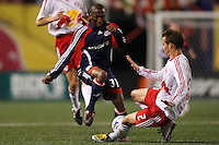 New York Red Bulls defender Kevin Goldthwaite (2) goes in for a tackle on New England Revolution midfielder Sainey Nyassi (31). The New York Red Bulls and the New England Revolution played to a 1-1 tie during a Major League Soccer match at Giants Stadium in East Rutherford, NJ, on April 19, 2008.