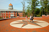 Photography of Charlotte NC's University of North Carolina at Charlotte campus (UNC Charlotte). UNCC, a public university located in northeast Charlotte, is part of the University of North Carolina higher education system. Opened in 1946, the campus has experienced explosive growth in recent years, including the addition of its Charlotte Research Institute campus and a football team.